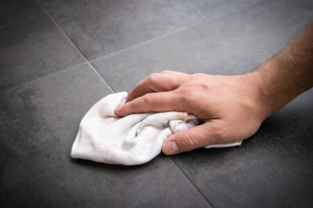 How to remove ceramic tile from concrete floor